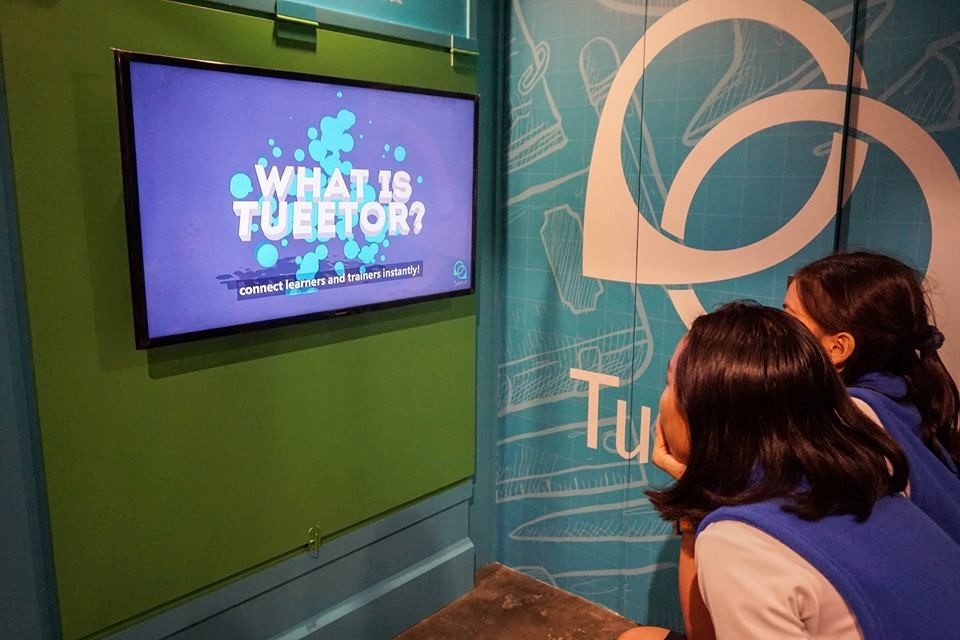 Kids in KidZania learning how to be a Tueetor training consultant
