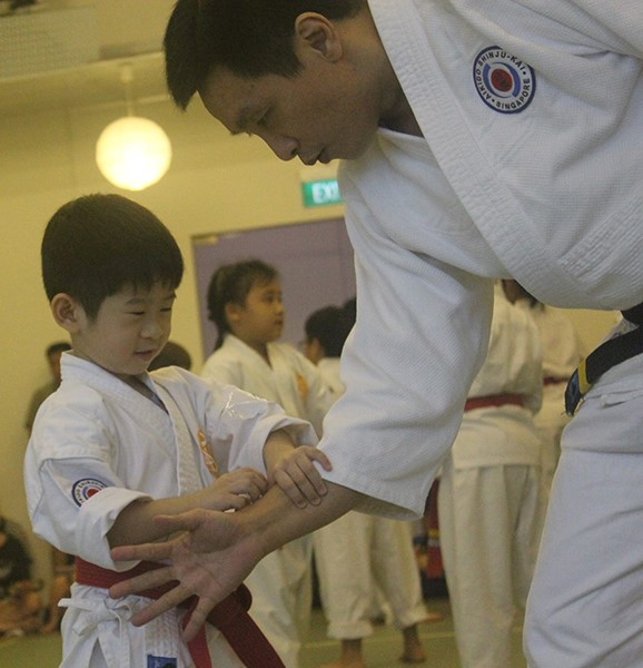 Student with his trainer at aikiForest